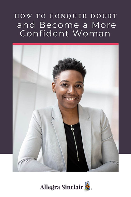 Confident woman smiling at the camera because she has conquered doubt